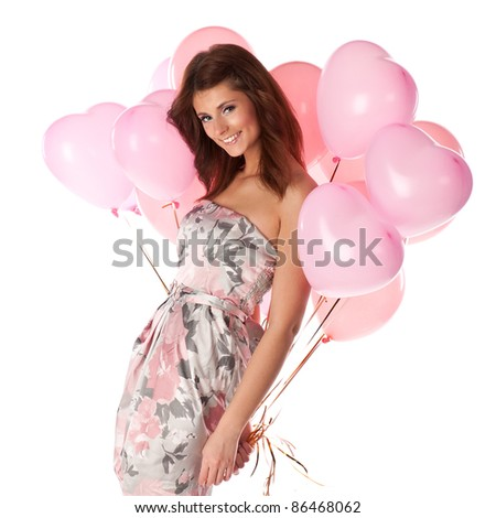 Young woman with pink balloons isolated on white