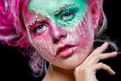 Young woman with pink dreads. Bizarre pink hair girl. Creative make up.  Halloween