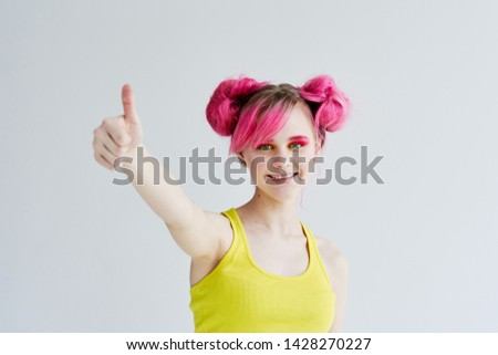 young woman with pink hair smiling showing thumbs up ok #1428270227