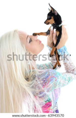 young woman with puppy in her hands isolated over white #63943570