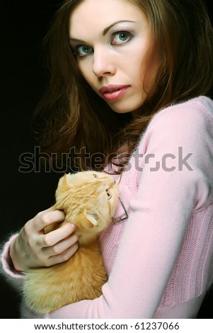 Young woman with red England lop-eared kitten