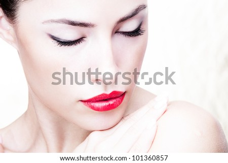 young woman with red lips, close up portrait