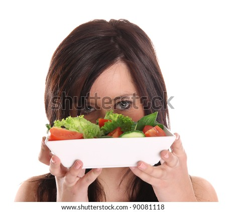 Young Woman with salad isolated on white