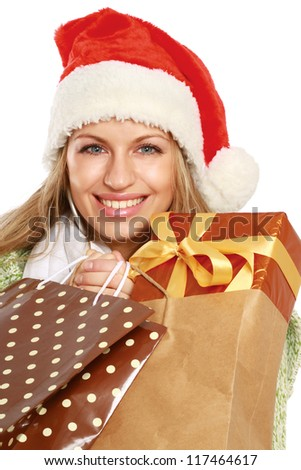 Young woman with Santa hat holding shopping bags, isolated on white background