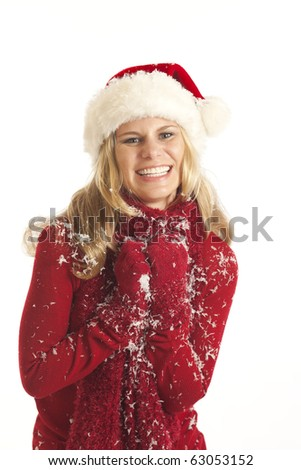 Young woman with Santa hat playing with snow