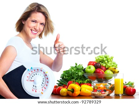 Young woman with scales and vegetables. Diet and fitness. Isolated ver white background