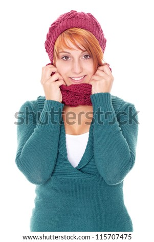 young woman with scarf and cap on a winter day