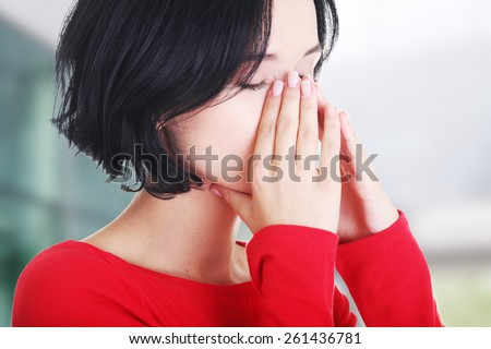 Young woman with sinus pressure pain.