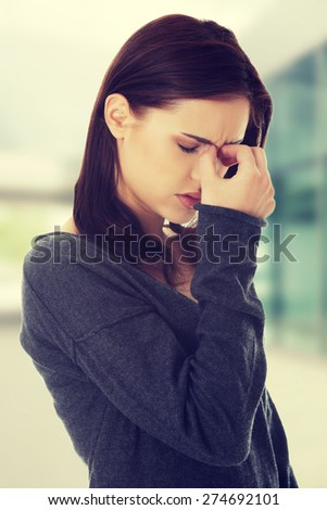 Young woman with sinus pressure pain