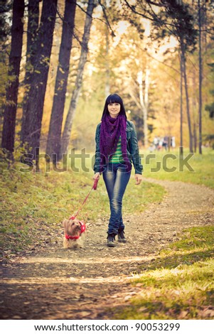 Young woman with small terrier dog