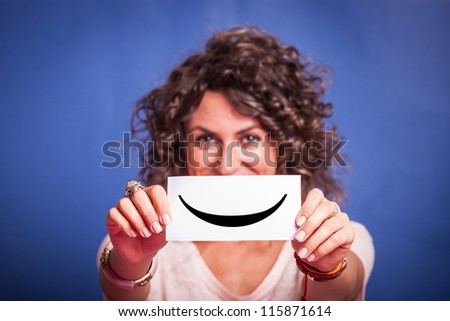 Young Woman with Smiley Emoticon on Blue Background