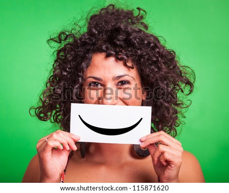 Young Woman with Smiley Emoticon on Green Background #115871620