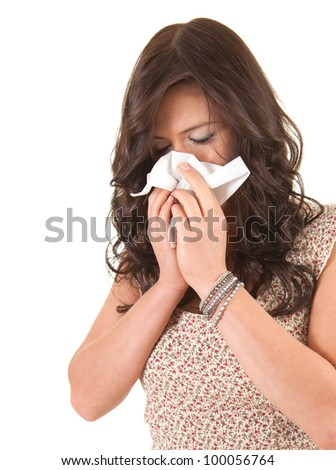 young woman with snotty, runny nose and tissue, white background