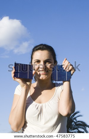 Young woman with solar cells