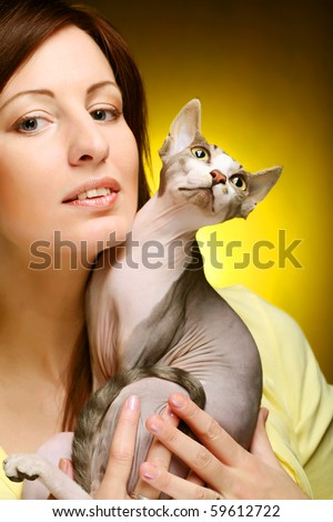 young woman with sphynx  cat - stock photo