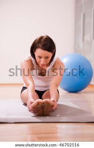 young woman with stability ball doing gymnastik sport coach