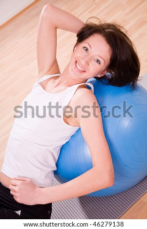 young woman with stability ball sport coach