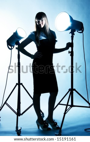 Young woman with studio flashes. Blue tint.