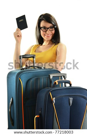Young woman with suitcases holding passport isolated on white. Female tourist with luggage