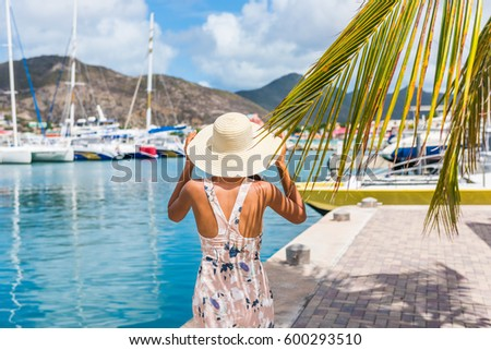 Young woman with sun hat in Philipsburg marina harbor, St Maarten, popular port of call for cruise ship travel destination. Netherlands Antilles, tropical summer vacation. #600293510