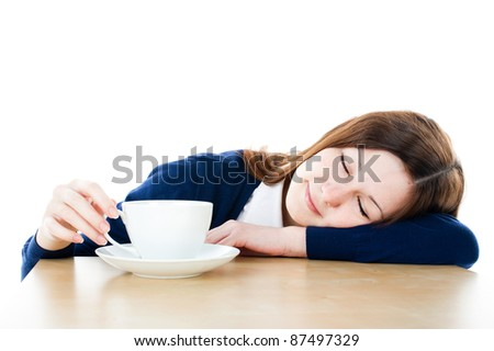 Young woman with tea and closed eyes