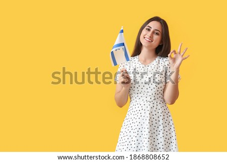 Young woman with the flag of Israel showing OK on color background Stok fotoğraf ©