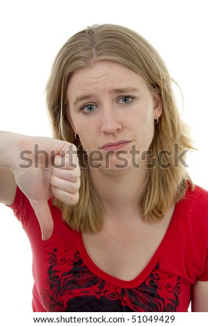 Young woman with thumb down over white background