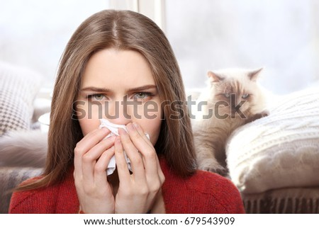 young woman with tissue and pet ...