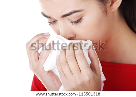 Young woman with tissue - sneezing