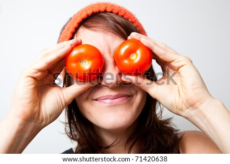 Young woman with tomato eyes. Studio shot.