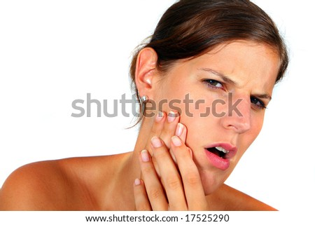 Young Woman With Toothache Young woman with a painful face. Holds her cheek because of hurting teeth. Isolated over white.