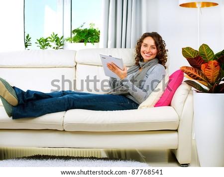 Young Woman With Touchpad At Home