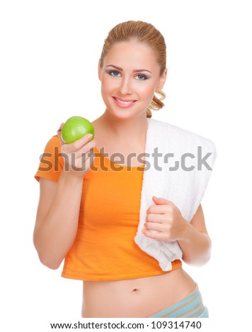 Young woman with towel  and apple isolated