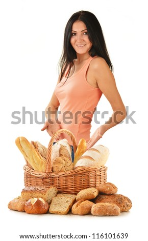 Young woman with variety of baking products isolated on white