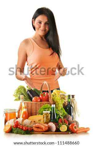 Young woman with variety of grocery products including vegetable, fruits, meat, dairy and wine