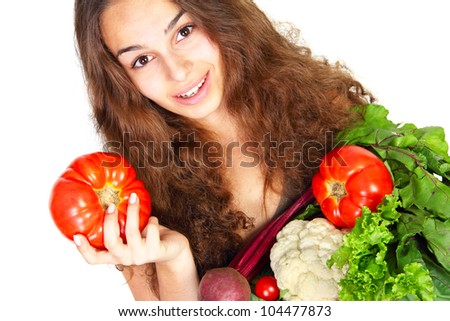 Young woman with vegetables isolated on white background