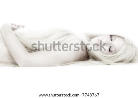 Young woman with very long hair covering her breasts, lying on the floor. - stock photo