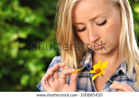 Young woman with yellow flower