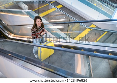 young woman with yellow suitcase. traveller in airport.