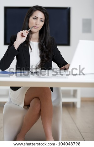 Young woman working at her desk in the office - stock photo