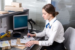 young woman working at the post office