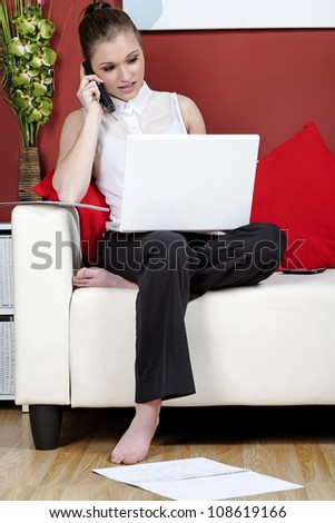 Young woman working from home on a laptop computer