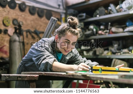 young woman working in a workshop Сток-фото ©