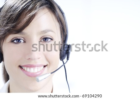young woman working in call center with haedphones