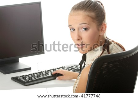 Young woman working on a computer, isolated on white