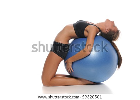 Young woman working out with a ball isolated on a white background - stock photo