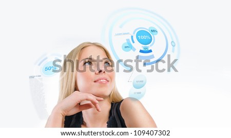 Young woman working with virtual interface against white background