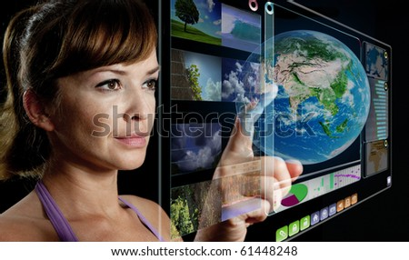 young woman works with futuristic display