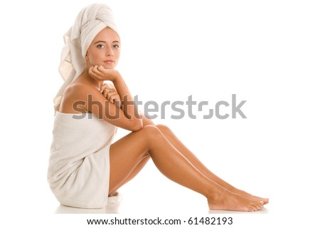 Young woman wrapped towel isolated on white background