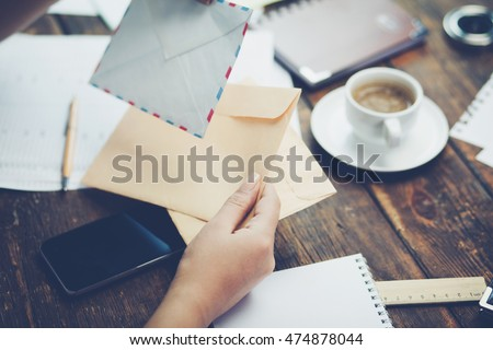 Young woman writing a letter. #474878044